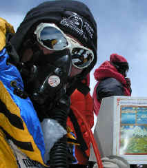 Tim Rippel using TopOut Mask summit of Mt. Everest